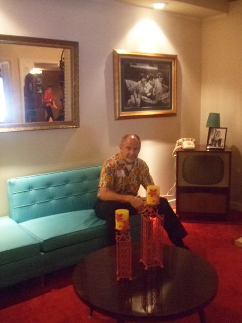 Elvis house living room hud seated